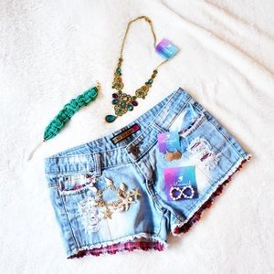 Distressed jean shorts with